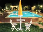 The pool terrace by night!