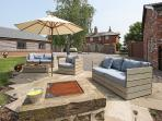 Nice outdoor area with umbrella and sofas