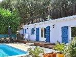 cottage with patio,pool garden furniture,a vast rooftop terrace,with sun loungers table and chairs.