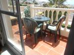 your terrace with breakfast table and sunbeds 17 m²