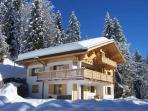Chalet Le Torrent sparkling in winter sunshine