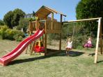 Childrens climbing frame and swings