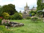 View of church from garden, available for use by guests