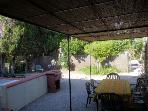 The Pumphouse shaded dining area and BBQ