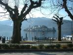 The Island of San Giulio from mainland Orta. Public boats or our aluminium boat are available.