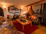 Downstairs lounge with fireplace, Africa bookshelf, Sky TV and DVD player. Ideal for children.