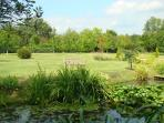 View of gardens and Badminton area from the pond