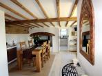 The dining room has an oak table with seating for four along with AGA, views across the front garden