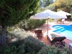Swimming-pool surrounded by terraces and a very tranquiel, private and exhuberant environment
