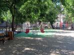 Nice modern playground for your kids, just come out the door