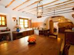 The big Old Bakery kitchen with 2 ovens, 4 sinks, dishwasher and large tables