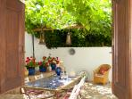 The vine-shaded courtyard