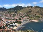 Machico town with sand beach