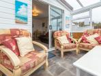 Comfortable seating in conservatory.