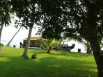 House boat parked to take guest from the villa