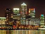 View of Canary Wharf from the balcony at night.