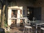 BBQ area off kitchen, perfect for late afternoon sun  (further BBQ available at pool area)