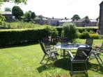 Cottage garden with table and chairs