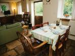Open plan dining room- sitting room in Jackdaw cottage