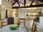 Fully equipped hand painted Mark Wilkinson kitchen with Aga stove, french doors to landscaped garden