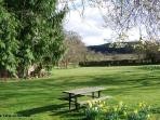 One of the three picnic tables on the lawn.  Plenty of space for a game of cricket.