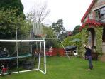 Football, Basket ball, Trampoline,swings with south facing lawn play area for croquet, badminton..