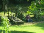 Brook at back of garden offers shaded tranquility
