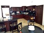 Formal kitchen w/ in-kitchen seating for 8. Coffee maker, toaster, blender, microwave & water cooler