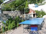 bar-b-que and ping-pong table