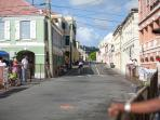 The Ironman Triathlon bikers ride through the heart of Christiansted.