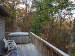 One of two 60 ft wrap around decks w/autumn view including tables/seating for 16