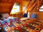 Spacious yet cozy loft with king size bed and 2 twins