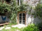 Garden with hamack, garden door and masterbedroom window above