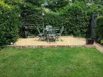 Private garden with BBQ and seating
