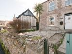 Charming end of terrace cottage, with side access to the private rear garden
