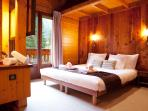 Marmotte Mountain Retreat Master Bedroom, offering a peaceful sleep.