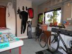 The Garage with with washing machine & dryer and games table.  Suitable for Golf Surfing Equipme