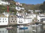 Beautiful Polperro harbour, Cobblestones marked  with red arrow..