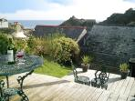 View from the garden upper deck. Perfect for outdoor eating  and sunbathing.Now with WiFi!