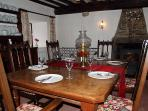 Oak dining table and woodburner in the dining room