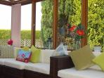Brand new 'rattan' furniture in the conservatory and garden views