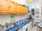 The kitchen is fully equipped has a small table which can seat two people
