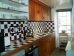 The kitchen with prestige equipment including espresso coffee maker..