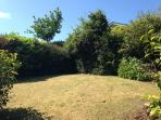 Our large lawn at the rear; Secured all round