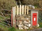 The post box by the front gate - from the days when the cottage was the old post office.