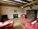 Comfortable lounge with satellite LCD TV& DVD. Wood burning stove for Autumn nights
