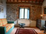 Apartement: living room, antique furniture and stone walls
