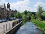 Walk alongside the Cuddy Burn from the Apartment to Peebles High Street