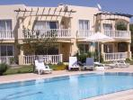 Prime Front Line Apartment Block overlooking Pool with Loungers and Umbrellas with Sea Views