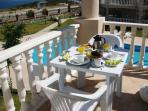 Breakfast on one of two balconies overlooking the adjoining pools.